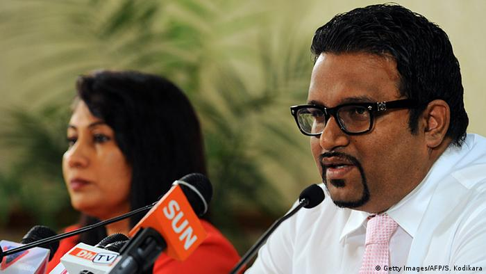 Ahmed Adeeb (R) speaks while Maldives Acting Minister of Foreign Affairs Mariyam Shakeela (L) looks on during a press conference in Male on November 11, 2013 (Photo: Ishara S.KODIKARA/AFP/Getty Images)