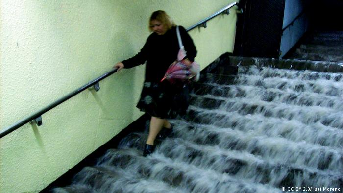 Water cascades down steps in the subway