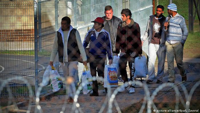 Migrants arrive at a refugee facility in the Czech Republic