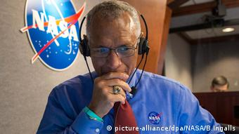 NASA administrator Charles Bolden Cape Canaveral contemplates successful space mission with chin in hand.