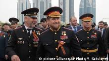 Chechen regional leader Ramzan Kadyrov, center, wearing a Russian military uniform, attends celebrations marking the 70th anniversary of the victory over Nazi Germany, in Chechnya's provincial capital Grozny, Russia, Saturday, May 9, 2015. (AP Photo/Musa Sadulayev)