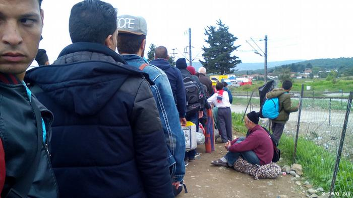 Refugees queue to cross the border into Macedonia