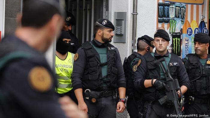 Spanish police stand gaurd after making an arrest.