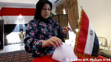 October 17, 2015. An Egyptian woman living in Bahrain casts her vote during the first stage of Egypt's parliamentary election at the Egyptian Embassy in Manama, Bahrain, October 17, 2015. REUTERS/Hamad I Mohammed