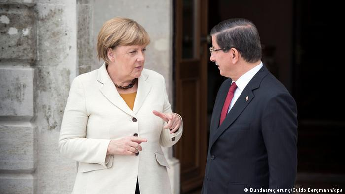 Merkel and Davutoglu discussing