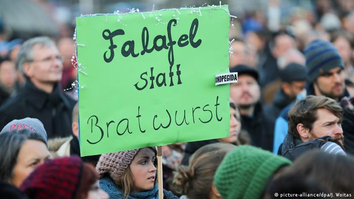 Counter-movement placard at Dresden PEGIDA rally reads: Falafel instead of sausage.