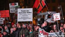 19.10.2015+++ DRESDEN, GERMANY - OCTOBER 19: Supporters of the Pegida movement gather at Theaterplatz square on the first anniversary since the first Pegida march on October 19, 2015 in Dresden, Germany. Pegida is an acronym for 'Patriotische Europaeer Gegen die Islamisierung des Abendlandes,' which translates to 'Patriotic Europeans Against the Islamification of the West,' and has strengthened its following since the surge of migrants and refugees arriving in Germany since August. A movement spokesman is demanding an immediate stop to Germany's admission of migrants and exclusion of all refugees and asylum seekers who are not Christians. Germany is expecting to receive well over one million asylum applicants this year and the challenge of accommodating and integrating so many people is creating divisions in German society that are becoming increasingly radical. (Photo by Sean Gallup/Getty Images)