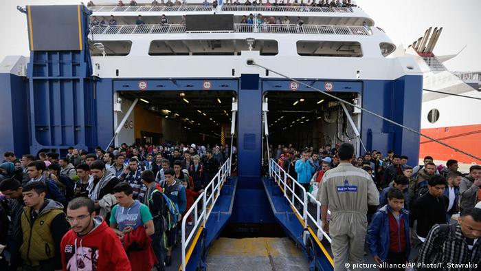 Migrants and refugees arrive on a ferry from the Greek island of Lesbos at the Athens' port of Piraeus