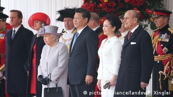 China's President Xi Jinping with his wife Peng Liyuan and British Queen Elizabeth II attend a traditional ceremonial welcome