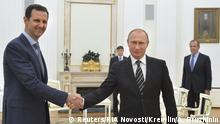 20.10.2015 **** Russian President Vladimir Putin (R) shakes hands with Syrian President Bashar al-Assad during a meeting at the Kremlin in Moscow, Russia, October 20, 2015. Assad made a surprise visit to Moscow on Tuesday evening to thank Putin for launching air strikes against Islamist militants in Syria. Picture taken October 20, 2015. REUTERS/Alexei Druzhinin/RIA Novosti/Kremlin ATTENTION EDITORS - THIS IMAGE HAS BEEN SUPPLIED BY A THIRD PARTY. IT IS DISTRIBUTED, EXACTLY AS RECEIVED BY REUTERS, AS A SERVICE TO CLIENTS.