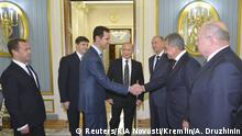 20.10.2015 **** Russian President Vladimir Putin (4th R) presents Defence Minister Sergei Shoigu (2nd R), Security Council Secretary Nikolai Patrushev (3rd R), Prime Minister Dmitry Medvedev (L) and other officials to Syrian President Bashar al-Assad (3rd L) during a meeting at the Kremlin in Moscow, Russia, October 20, 2015. Assad made a surprise visit to Moscow on Tuesday evening to thank Putin for launching air strikes against Islamist militants in Syria. Picture taken October 20, 2015. REUTERS/Alexei Druzhinin/RIA Novosti/Kremlin ATTENTION EDITORS - THIS IMAGE HAS BEEN SUPPLIED BY A THIRD PARTY. IT IS DISTRIBUTED, EXACTLY AS RECEIVED BY REUTERS, AS A SERVICE TO CLIENTS.