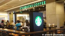 ILLUSTRATION+++ FILE--Customers enjoy coffee at a Starbucks Coffee Cafe in Shenzhen city, south China's Guangdong province, 3 August 2015. Foreign direct investment (FDI) in China approached 584.74 billion yuan ($92.39 billion) in the first nine months of this year, up 9 percent year-on-year, data from the Ministry of Commerce (MOFCOM) showed on Monday (12 October 2015). The MOFCOM said that China is maintaining good momentum in attracting foreign investment and the rebound in FDI was closely related to comprehensive government measures to deepen reform and opening-up and create a better business environment. The total number of foreign companies seeking to invest in China reached 18,980 from January to September, up 10.1 percent, according to the MOFCOM, which also said that the number of new foreign companies rose 5.2 percent to 2,153 in September. Foreign investment in the advanced sectors of the service and manufacturing industries kept rising in the first nine months, with FDI in the high-tech services industry growing 57.6 percent to $6.16 billion, which accounted for 17.1 percent of FDI in the services sector, according to the MOFCOM.