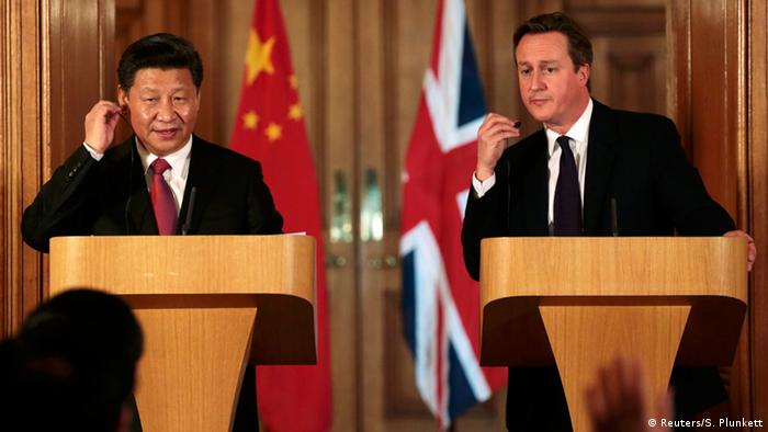 China's President Xi Jinping and Britain's Prime Minister David Cameron attend a joint press conference