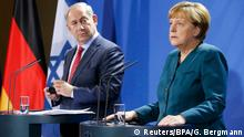 Israeli Prime Minister Benjamin Netanyahu and German Chancellor Angela Merkel hold a joint news conference at the Chancellery in Berlin, Germany October 21, 2015. REUTERS/Guido Bergmann/BPA