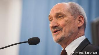 Defense Minister Antoni Macierewicz speaks into a microphone.