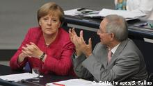 9.7.2011 BERLIN, GERMANY - JUNE 09: German Chancellor Angela Merkel speaks with Finance Minister Wolfgang Schaeuble after she gave a government declaration at the Bundestag on Germany's future energy policy on June 9, 2011 in Berlin, Germany. Schaeuble recently announced that Greece will need an additional EUR 90 billion in order to avoid bankruptcy. Greece is teetering on the edge of a financial abyss that many analysts fear could have disastrous consequences for the Eurozone economies. Copyright: Getty Images/S. Gallup
