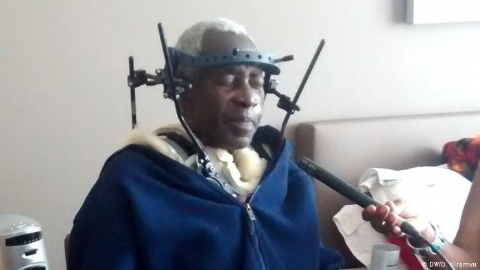 Pierre-Claver Mbonimpa carrying a brace after surgery