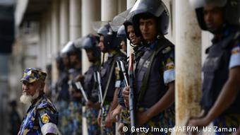 Bangladeshi police stand guard outside a special court in Dhaka