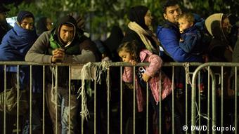 people alongside a fence Copyright: Diego Cupolo