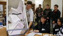 25.10.2015 *** A member of a local electoral commission empties a ballot box after a regional election at a polling station in Kiev, Ukraine, October 25, 2015. Local elections in Ukraine's port city of Mariupol were called off on Sunday, prompting the ruling party of President Petro Poroshenko and the pro-Russian Opposition Party to blame each other for alleged irregularities in the vote. REUTERS/Gleb Garanich TPX IMAGES OF THE DAY Reuters/G. Garanich