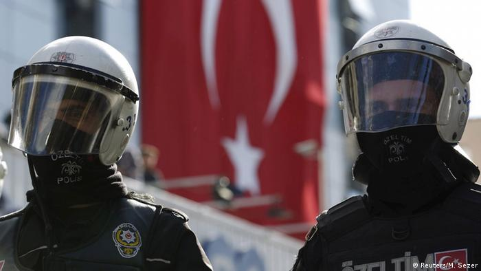 Riot police stand guard outside of a TV building in Istanbul, Turkey.