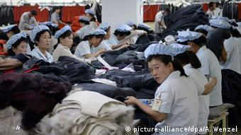 Workers at a garment factory in an inter-Korean industrial complex in the North Korean border city of Kaesong