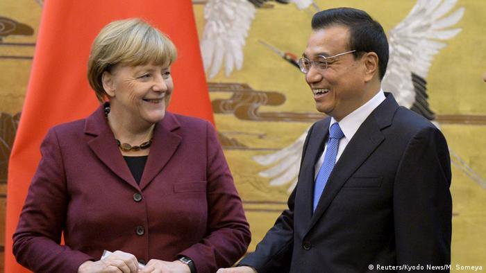 Канцлерка ФРН Анґела Меркель (л) та глава уряду Китаю Лі Кецян