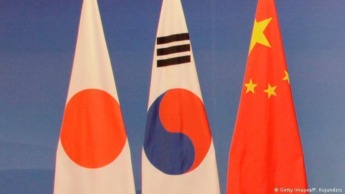 Japan, South Korea and China flags