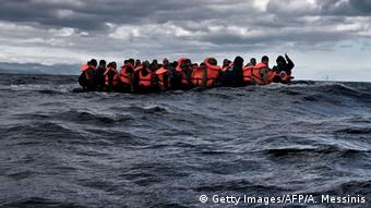 An inflatable boat packed with migrants is adrift in the Mediterranean Sea.