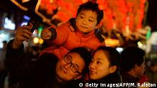 A young Chinese boy wearing horns poses for a photo with his parents as they visit the Lantern Festival decorations in the Yuyuan Gardens of Shanghai on February 15, 2014. China celebrates the traditional Lantern Festival which formally marks the end of celebrations for the Chinese Lunar New Year period, 15 days after it began, and is celebrated by viewing lanterns and setting off fireworks, among other activities. AFP PHOTO/Mark RALSTON (Photo credit should read MARK RALSTON/AFP/Getty Images) +++ Copyright: Getty Images/AFP/M. Ralston