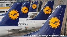 FILE - In this April 2, 2014 file picture Lufthansa aircrafts are parked as Lufthansa pilots went on a three-days-strike in Frankfurt, Germany. Lufthansa is raising its full-year earnings outlook in light of a strong third-quarter performance and lower oil prices, the company said Thursday Oct. 29, 2015. (AP Photo/Michael Probst,file) +++ Copyright: picture-alliance/AP Photo/M. Probst
