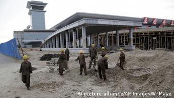 North Korean soldier-builders work on the new building of the Sunan International Airport, Monday, Oct. 27, 2014 in Pyongyang, North Korea (AP Photo/Wong Maye-E)
