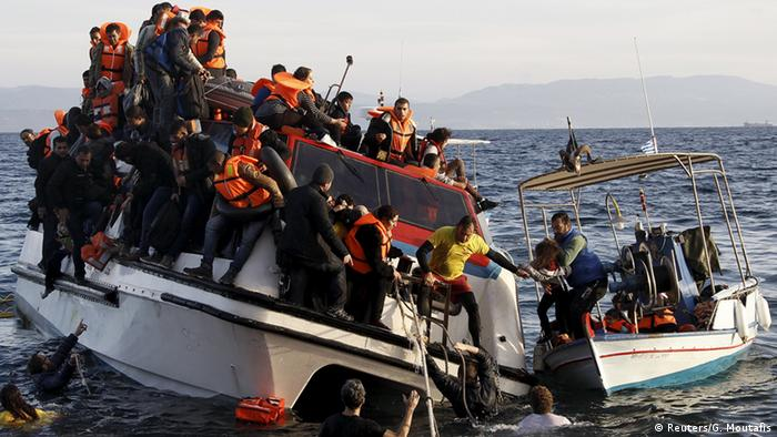 A Greek fishing boat rescues Syrian war refugees from a half-sunken catamaran off of the Greek Island of Lesbos.