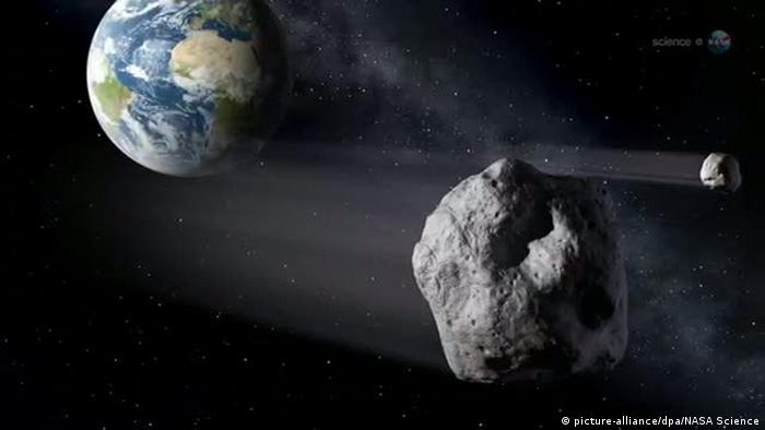Illustration of asteroid traveling through space, with earth looming in the background