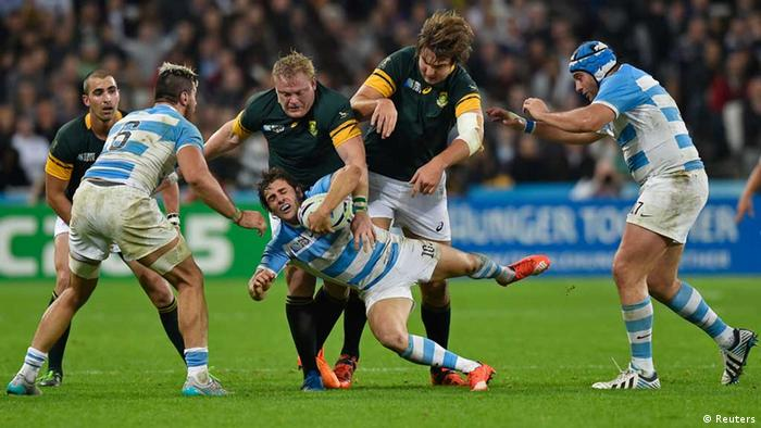 Rugby players on the field as South Africa beats Argentina 24-13 in London.