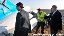 31.10.2015 *** epa05005072 The Egyptian Prime Minister, Sherif Ismail (R), examines the wreckage at the site of the Russian plane crash, Sinai, Egypt, 31 October 2015. According to reports the Egyptian Government has dispatched more than 45 ambulances to the crash site of the Kogalymavia Metrojet Russian passenger jet, which disappeared from raider after requesting an emergency landing early 31 October, crashing in the mountainous al-Hasanah area of central Sinai. The black box has been recovered at the site. EPA/STR EGYPT OUT