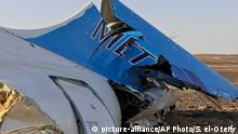 31.10.2015 *** This image released by the Prime Minister's office shows the tail of a Metrojet plane that crashed in Hassana Egypt, Friday, Oct. 31, 2015. The Russian aircraft carrying 224 people, including 17 children, crashed Saturday in a remote mountainous region in the Sinai Peninsula about 20 minutes after taking off from a Red Sea resort popular with Russian tourists, the Egyptian government said. There were no survivors.(Suliman el-Oteify, Egypt Prime Minister's Office via AP)