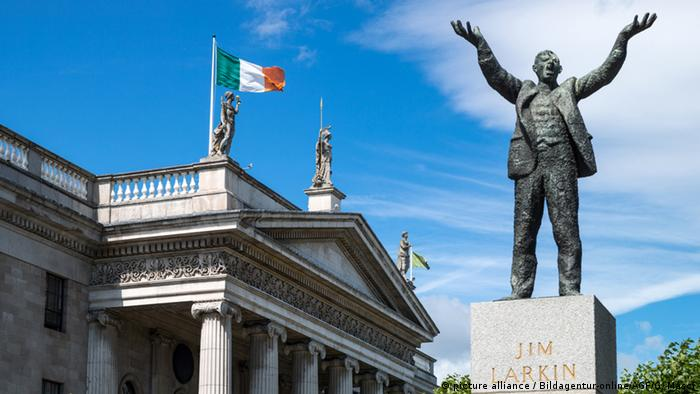 A statue of trade unionist Jim Larkin with his hands gestutring for people to rise stands in front of Dublin's main post office