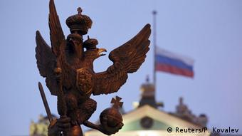 Russian eagle and flag REUTERS/Peter Kovalev