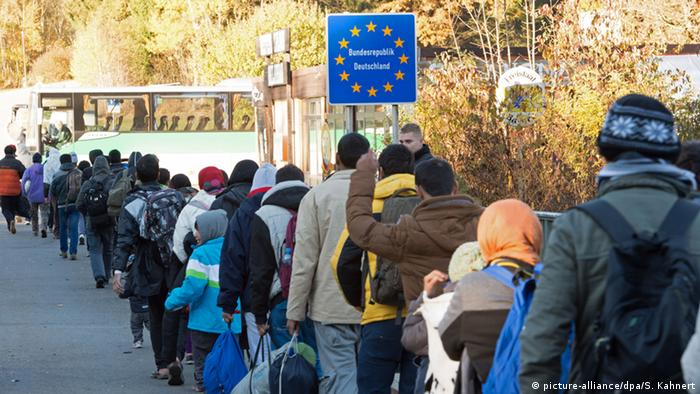 Refugees wait in line at the Austrian-German border