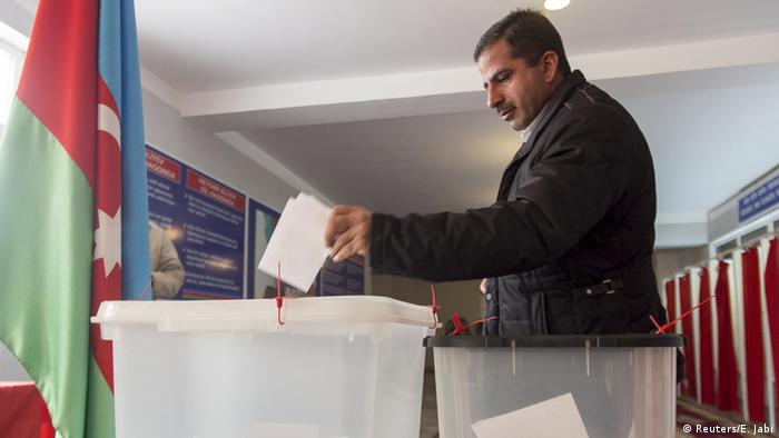 A man casts his ballot at a polling station during the parliamentary election in Baku, Azerbaijan November 1, 2015.
