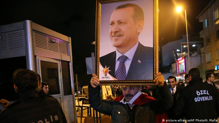 AKP supporters hold up a picture of president Erdogan.