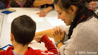 teacher talking to pupil Copyright: Gemima Harvey