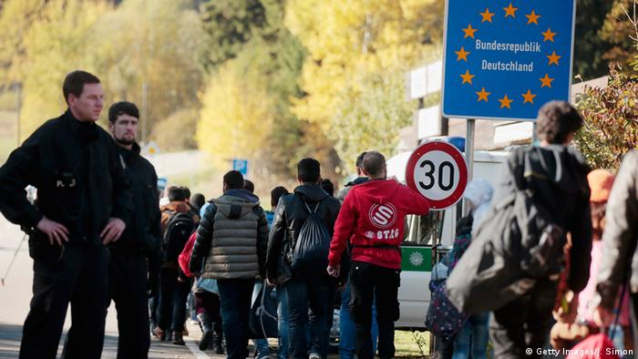 Migrants cross the German border to Austria
