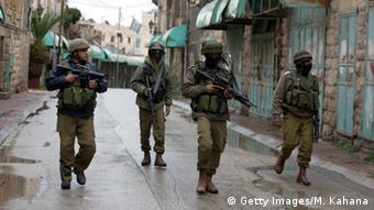 Israeli soldiers on patrol in Hebron.