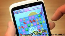 Candy Crush Handy Spiel als Symbolbild zur Fusion Activision Blizzard und King Digital Entertainment