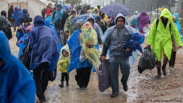 Refugees in the rain in Greece