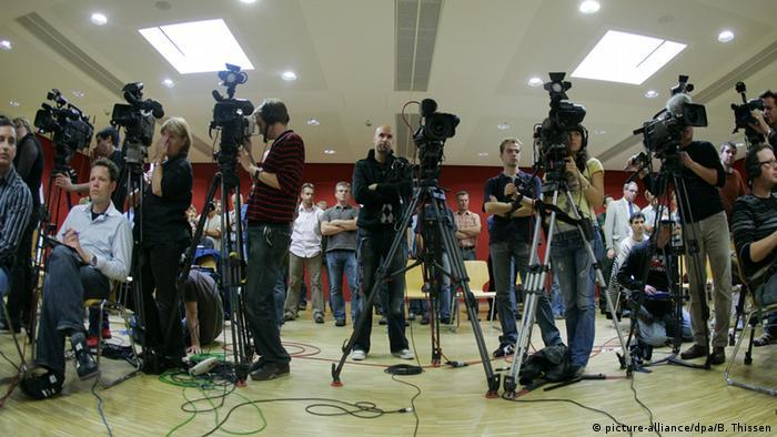 Журналисты с телекамерами