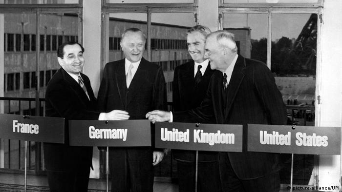 Standing in Paris in 1954, German Chancellor Konrad Adenauer stands alongside his French counterpart, Pierre Mendes, British Foreign Minister Sir Anthony Eden and US Secretary of State John Foster Dulles