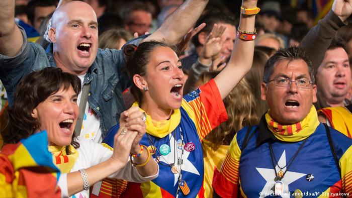 Catalonian people celebrate historic vote